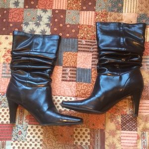 Black high heeled Predictions boots